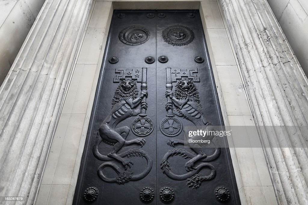Decorative designs cover closed side doors at the Bank of England (BoE) in London, U.K., on Thursday, March 7, 2013. The pound dropped to its weakest level in more than 2 1/2 years versus the dollar before Bank of England policy makers announce their decision on whether they will add more stimulus to boost the U.K. economy. Photographer: Simon Dawson/Bloomberg via Getty Images