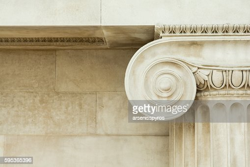 Decorative detail of an ancient Ionic column : Photo