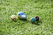 Decorative Easter eggs in grass
