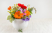 Decorative fresh flowers in a white vase