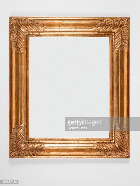 A Decorative Gold Frame on a White Wall