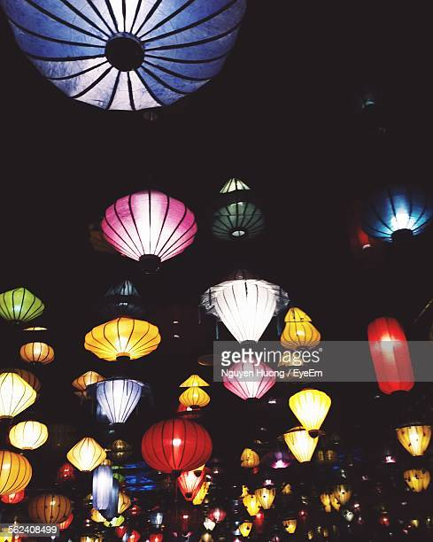 Decorative Lamps Hanging On Street At Night