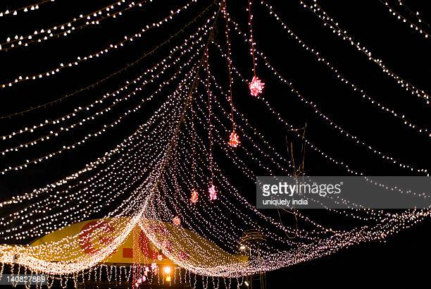 Decorative lights of a wedding tent lit up at night