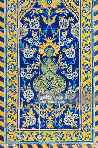 Decorative paintings on a wall dome of the Shah mosque in Esfahan, Iran