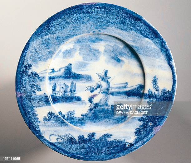 Decorative plate with a male figure in a landscape maiolica GrossoLevantino manufacture Albisola Liguria Italy 18th century Trieste Civico Museo...
