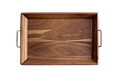 Decorative rectangular olive wood tray showing the light and dark pattern of the grain with brass handles, overhead view isolated on white
