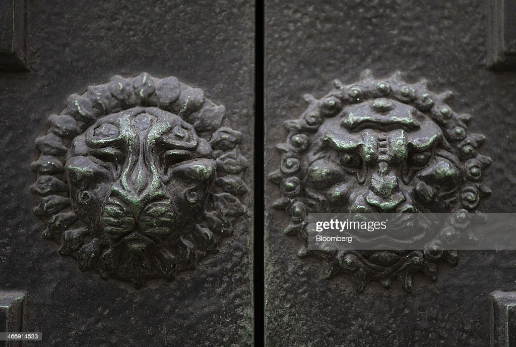Decorative reliefs sit on the doors of the Bank of England in London, U.K., on Tuesday, Feb. 4, 2014. Between 2007 and 2011, policy makers in London lagged behind their American counterparts in cutting rates and adopting emergency policy measures in response to the financial crisis. Photographer: Simon Dawson/Bloomberg via Getty Images