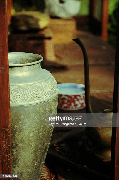 Decorative Urn With Antique Tea Kettle