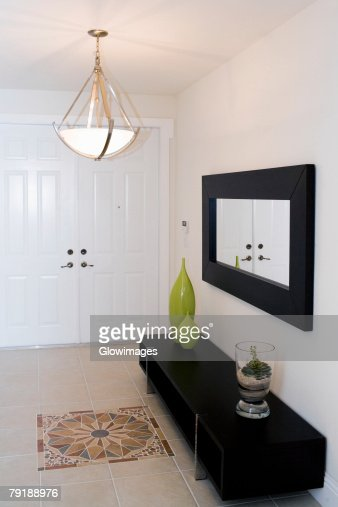 Decorative urns on a cabinet : Stock Photo
