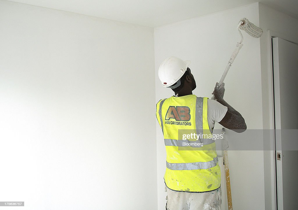 A decorator paints the inside of an apartment at the Oval Quarter, a shared ownership, private and social residential housing complex developed by Higgins Group Plc in partnership with Nottinghill Housing and Pinnacle Regeneration Group, in London, U.K., on Monday, Aug. 5, 2013. U.K. house prices rose 0.8 percent in July, from 0.3 percent the previous month, Nationwide Building Society said. Photographer: Simon Dawson/Bloomberg via Getty Images