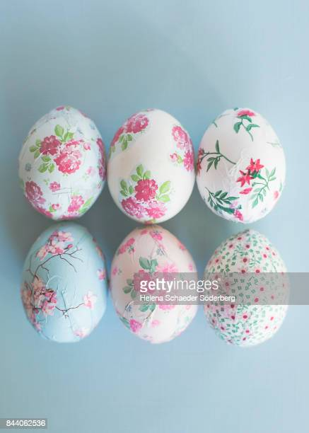 Decoupage easter eggs on light blue background