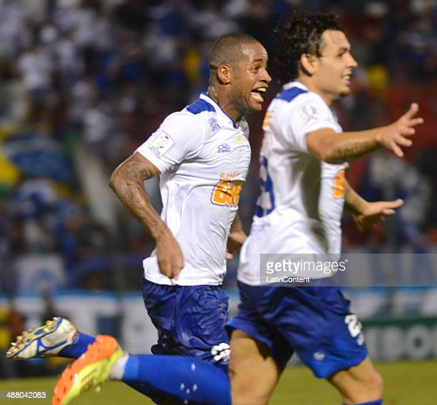 Dede and Alisson of Cruzeiro celebrate a scored goal during a match between Cerro Porteno and Cruzeiro as part of the second leg of round of...