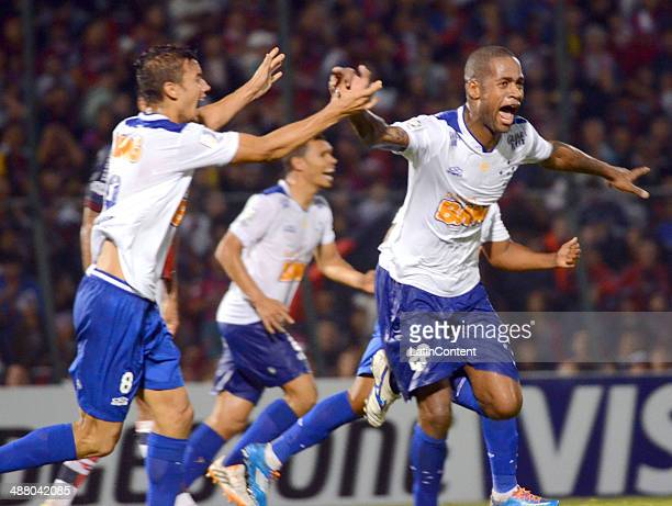 Dede and Henrique of Cruzeiro celebrate a scored goal during a match between Cerro Porteno and Cruzeiro as part of the second leg of round of...