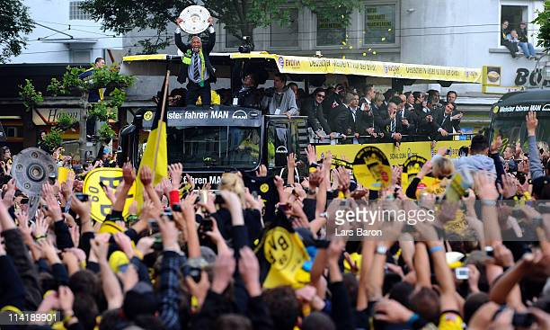 Dede lift the trophy and celebrates winning the German championship with team mates and fans during the Borussia Dortmund Bundesliga winners parade...