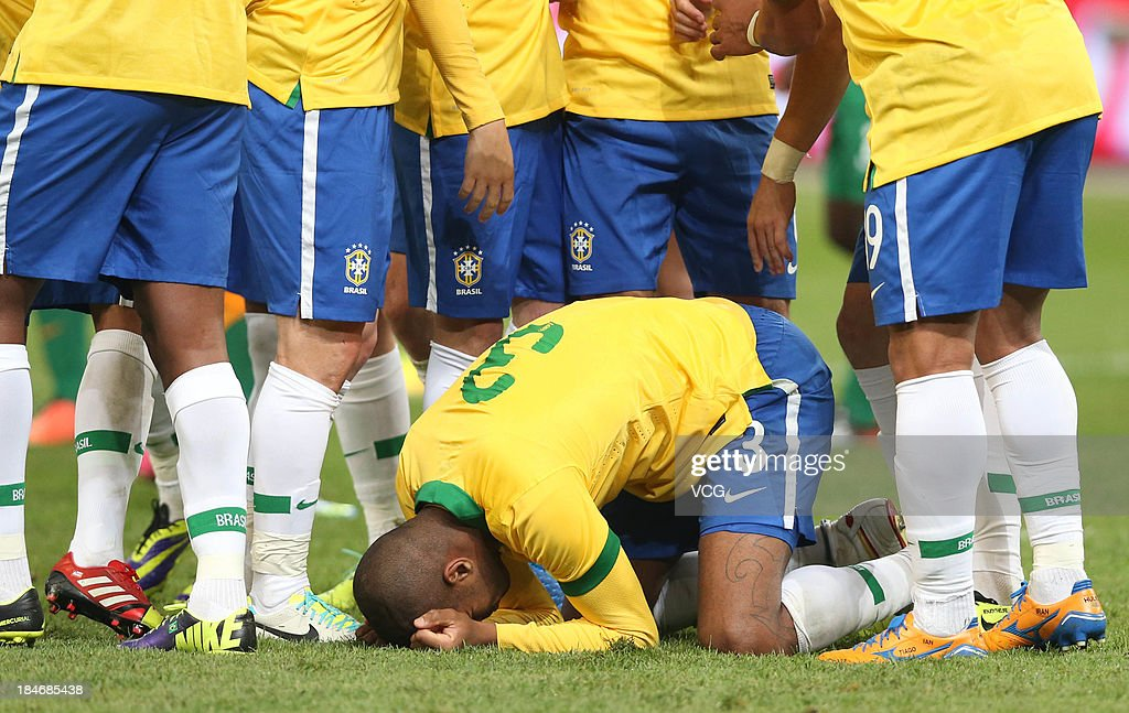 Dede #3 of Brazil celebrates with team mates after scoring his team's second goal during the international friendly match between Brazil and Zambia at Beijing National Stadium on October 15, 2013 in Beijing, China.