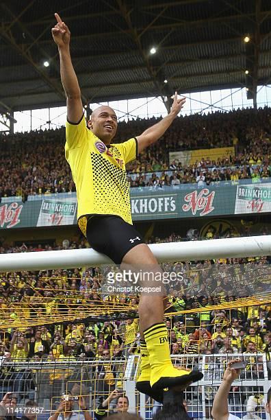 Dede of Dortmund celebrates after winning the German Champions trophy after the Bundesliga match between Borussia Dortmund and Eintracht Frankfurt at...