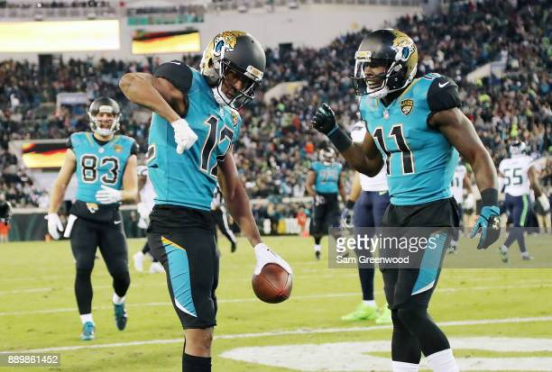 Dede Westbrook and Marqise Lee of the Jacksonville Jaguars celebrate after Westbrook scored an 18yard touchdown against the Seattle Seahawks during...