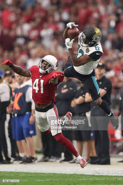 Dede Westbrook of the Jacksonville Jaguars is unable to complete the pass against Antoine Bethea of the Arizona Cardinals in the first half at...