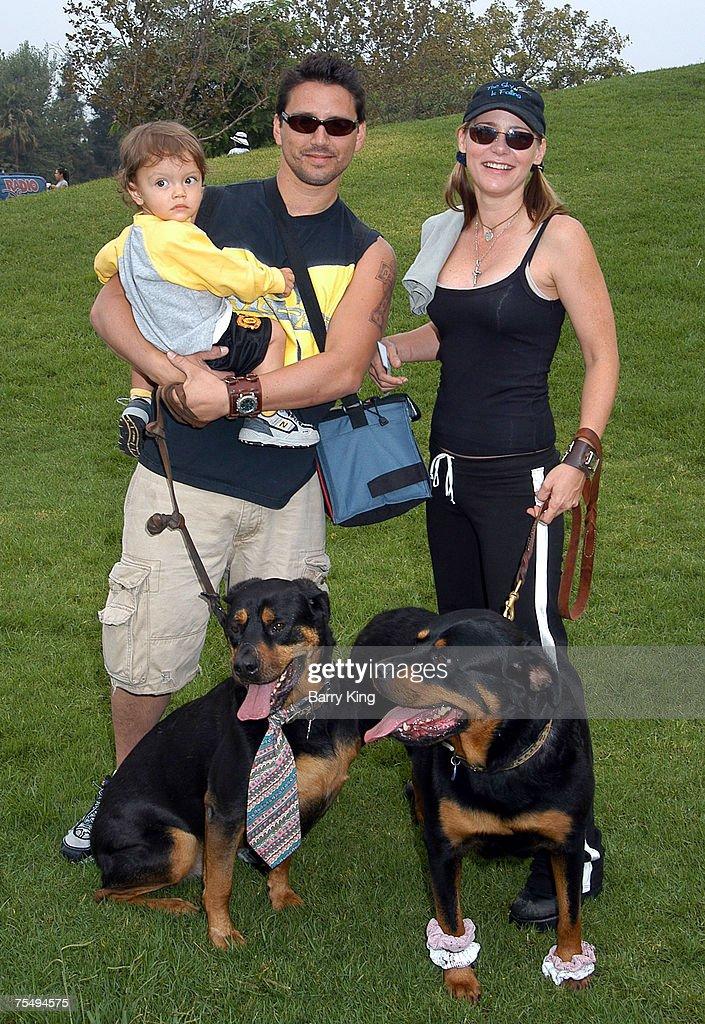 Dedee Pfeiffer & husband Santiago & son Braxten Alexandre & their dogs Butch & Chloe at the La Brea Tar Pits in Los Angeles, California