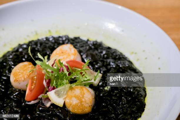 Dedicated Dish, Scallops on Bed of Black Risotto with Olive oil