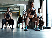 Shot of a fitness group working out with kettle bells in a gym