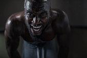 Sweaty man during intense workout.