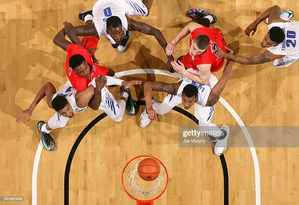 Dedric Lawson and KJ Lawson of the Memphis Tigers box out Marcanvis Hymon and Tomasz Gielo of the Ole Miss Rebels on December 18 2015 at FedExForum...