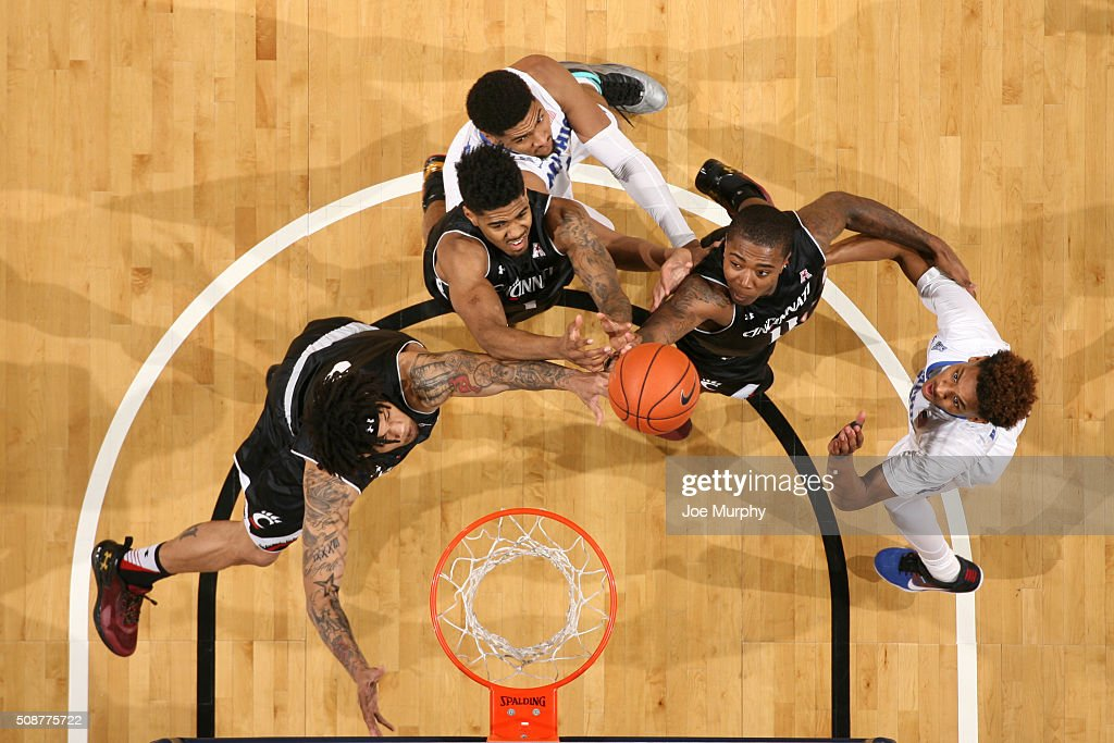 <a gi-track='captionPersonalityLinkClicked' href=/galleries/search?phrase=Dedric+Lawson&family=editorial&specificpeople=13538393 ng-click='$event.stopPropagation()'>Dedric Lawson</a> #1 of the Memphis Tigers jumps for a rebound against Jacob Evans #1 and Gary Clark #11 of the Cincinnati Bearcats on February 6, 2016 at FedExForum in Memphis. Memphis defeated Cincinnati 63-59.