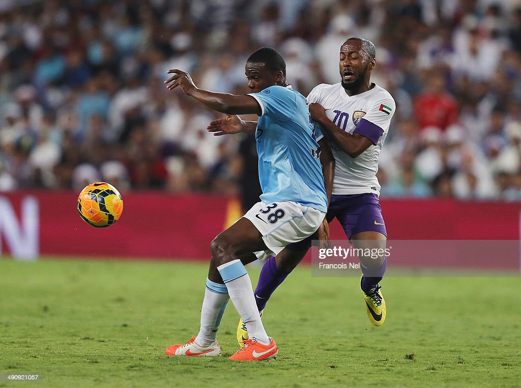 Dedryck Boyata of Manchester City competes for the ball with Omar Abdulrahman of Al Ain during the friendly match between Al Ain and Manchester City at Hazza bin Zayed Stadium on May 15, 2014 in Al Ain, United Arab Emirates.