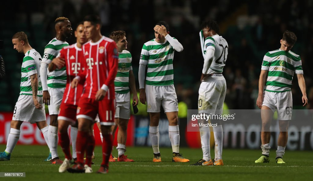 Dedryck Boyata, Tomas Rogic and Kieran Tierney of Celtic of Celtic react at full time during the UEFA Champions League group B match between Celtic FC and Bayern Muenchen at Celtic Park on October 31, 2017 in Glasgow, United Kingdom.