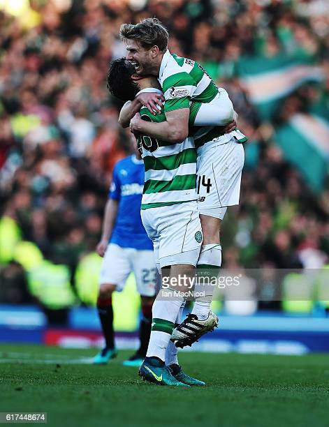Dedyck Boyata celebrates with Stuart Armstrong of Celtic at full time during the Betfred Cup Semi Final match between Rangers and Celtic at Hampden...