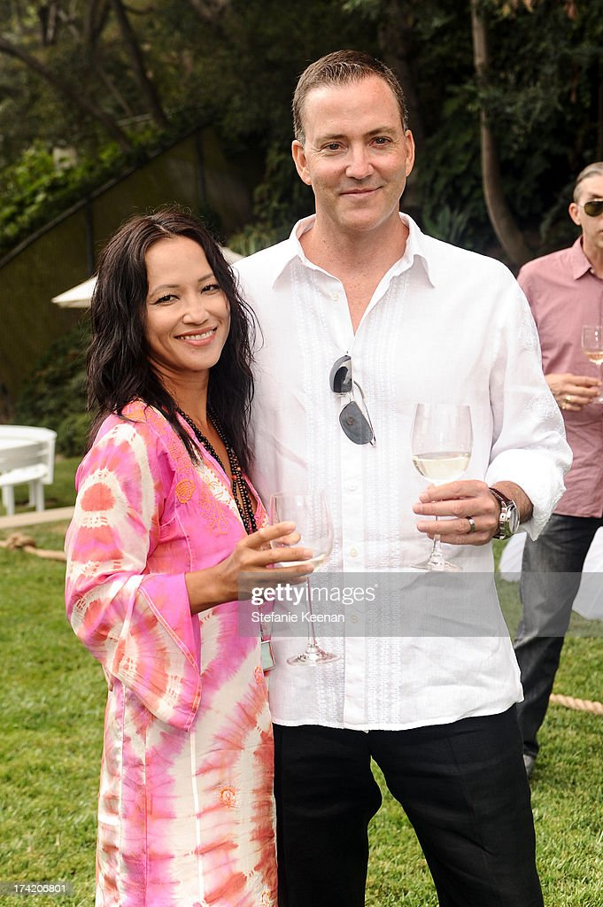 Dee Abel and Louis Abel attend LAXART 2013 Garden Party on July 21, 2013 in Los Angeles, California.