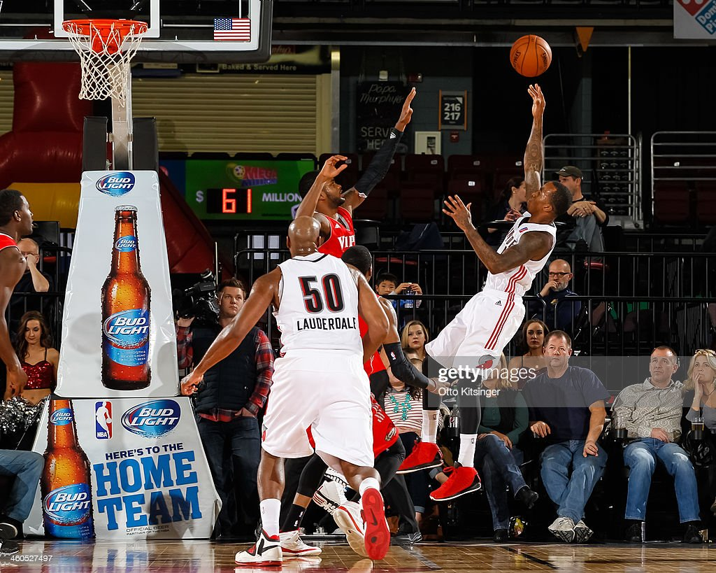 Dee Bost of the Idaho Stampede shoots over Troy Daniels of the Rio Grande Valley Vipers during an NBA DLeague game on January 3 2014 at CenturyLink...