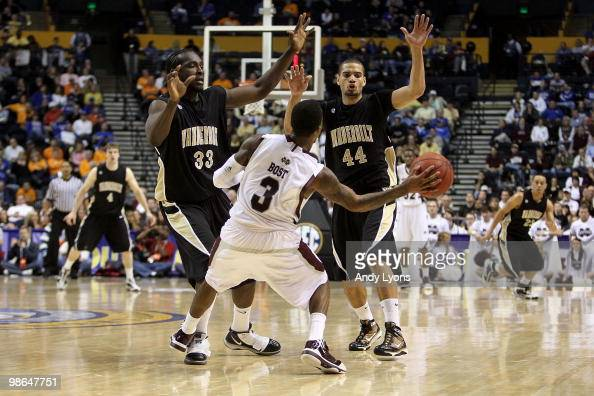 Dee Bost of the Mississippi State Bulldogs looks to pass the ball as he is defended by Steve Tchiengang and Jeffery Taylor of the Vanderbilt...