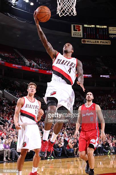 Dee Bost of the Portland Trail blazers goes up for the layup against the Los Angeles Clippers on October 7 2013 at the Moda Center Arena in Portland...