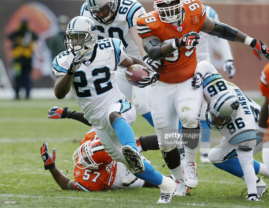 Dee Brown #22 of the Carolina Panthers rushes for a first down against the Cleveland Browns on December 1, 2002 at Browns Stadium in Cleveland, Ohio. Carolina won the game 13-6.