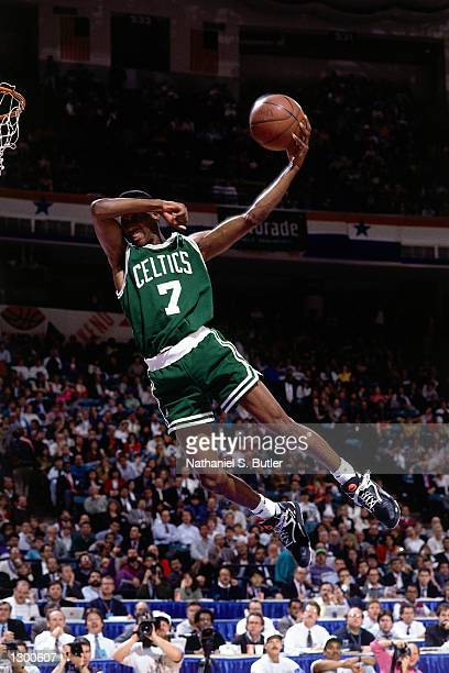 Dee Brown#7 of the Boston Celtics goes up for a no look slam dunk in the Slam Dunk Contest during the 1990 NBA AllStar Weekend at The Miami Arena in...