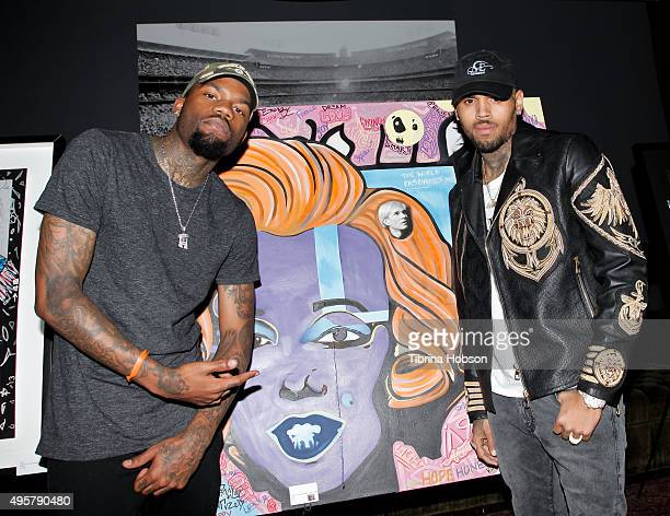 Dee Cosey and Chris Brown pose by their painting at 'The Lost Warhols' Collection exhibit at HYDE Sunset Kitchen Cocktails on November 4 2015 in West...