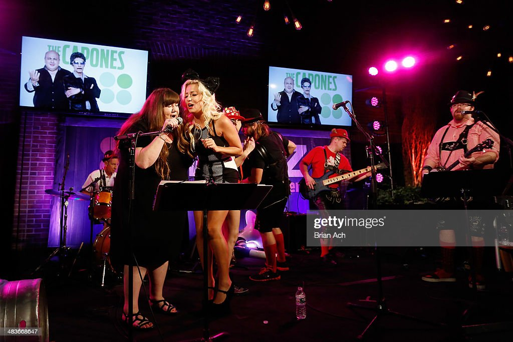 Dee Dee Peters (L) of Hollywood Hillbillies and Georgina Leahy of Treasure King perform onstage with The Chardon Polka Band at the REELZ Channel upfront presentation at Hudson Hotel on April 9, 2014 in New York City.