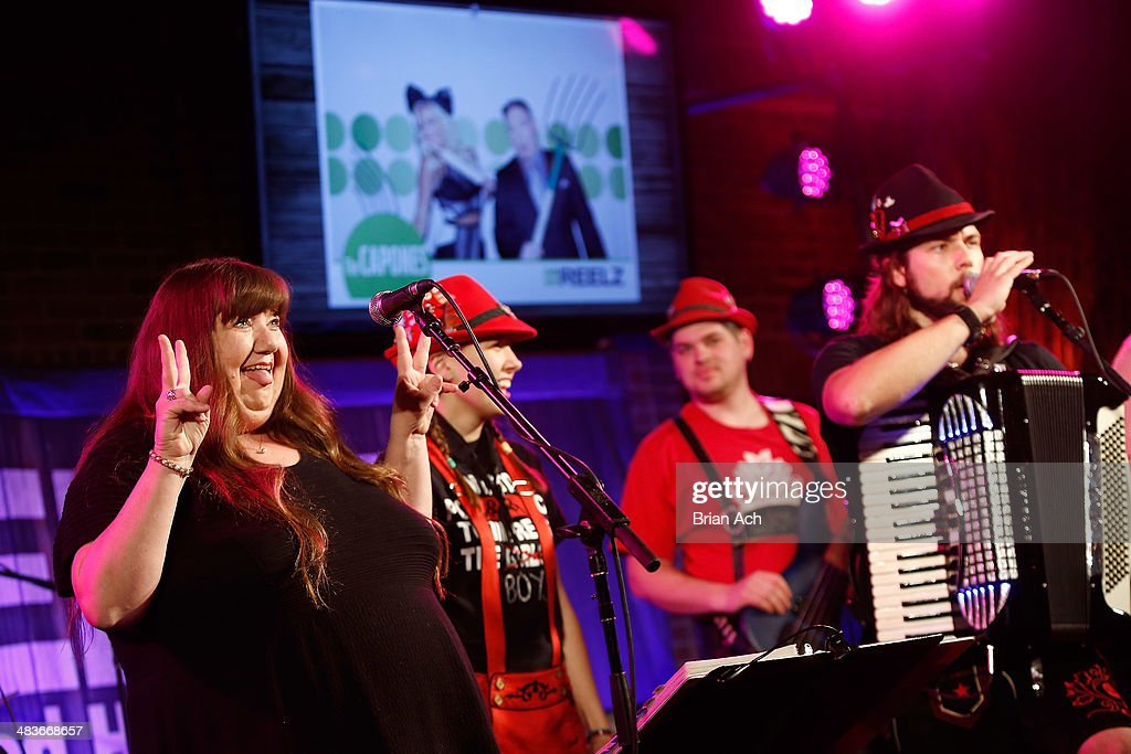 Dee Dee Peters (L) of Hollywood Hillbillies performs onstage with The Chardon Polka Band at the REELZ Channel upfront presentation at Hudson Hotel on April 9, 2014 in New York City.