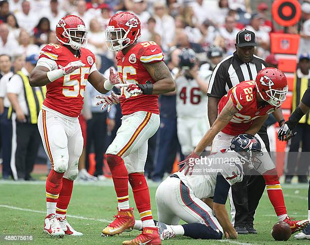 Dee Ford of the Kansas City Chiefs celebrates Derrick Johnson sack against Brian Hoyer of the Houston Texans in the second half in a NFL game on...