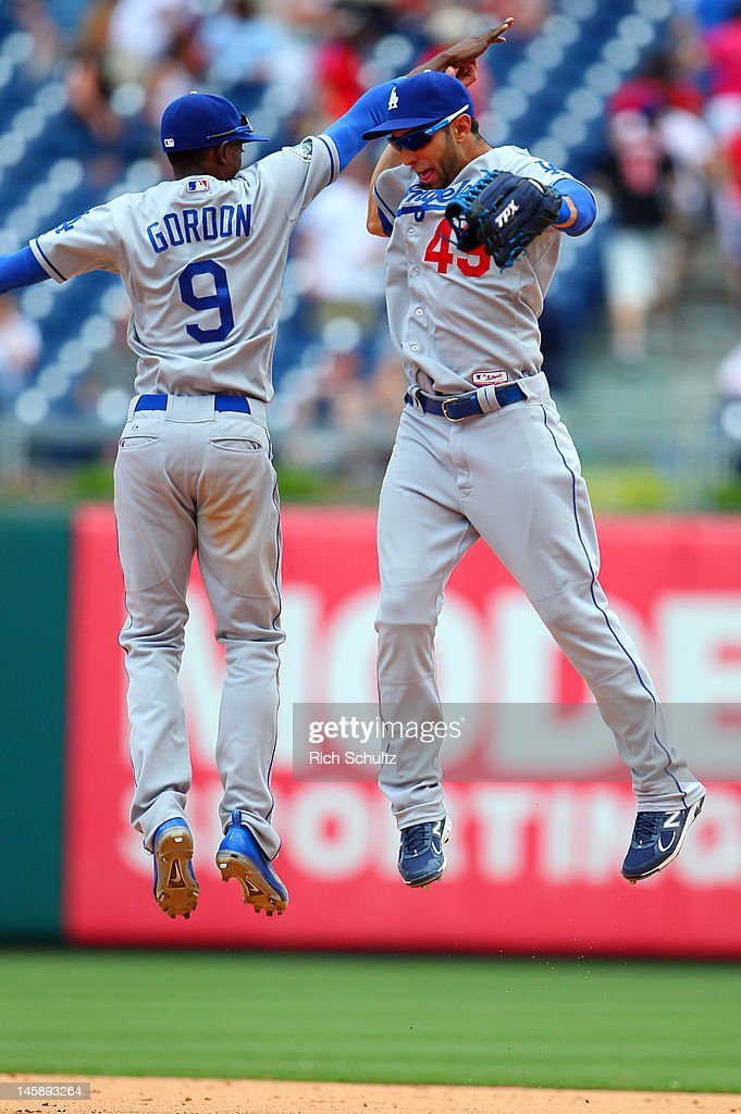 <a gi-track='captionPersonalityLinkClicked' href=/galleries/search?phrase=Dee+Gordon&family=editorial&specificpeople=7091343 ng-click='$event.stopPropagation()'>Dee Gordon</a> #9 and Alex Castellanos #49 of the Los Angeles Dodgers high five each other after defeating the Philadelphia Phillies 8-3 in a MLB baseball game on June 7, 2012 at Citizens Bank Park in Philadelphia, Pennsylvania.