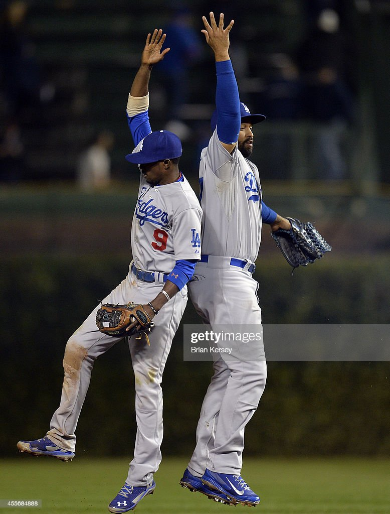 Dee Gordon #9 and Matt Kemp #27 of the Los Angeles Dodgers celebrate a win over the Chicago Cubs at Wrigley Field on September 18, 2014 in Chicago, Illinois. The Dodgers defeated the Cubs 8-4.