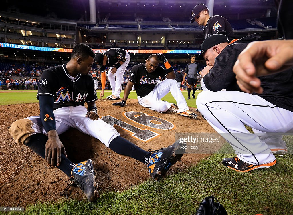 Dee Gordon, Marcell Ozuna, Martin Prado, Marcell Ozuna, and Miguel Rojas of the Miami Marlins gather around the pitching mound after the game against the New York Mets at Marlins Park on September 28, 2016 in Miami, Florida.