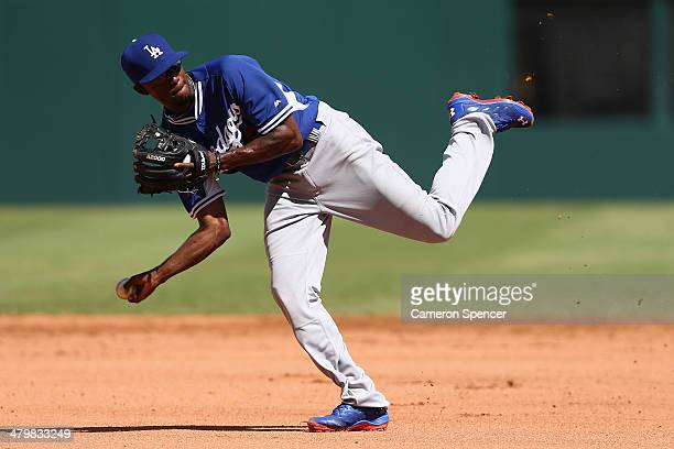Dee Gordon of the Dodgers fields during a Los Angeles Dodgers MLB training session at Sydney Cricket Ground on March 21 2014 in Sydney Australia