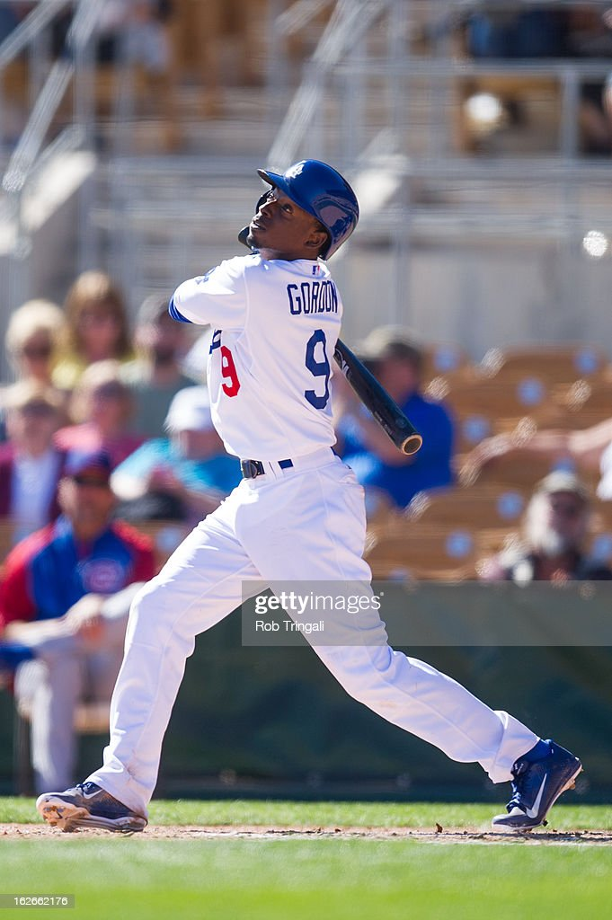 Dee Gordon #9 of the Los Angeles Dodgers bats during a spring training game against the Chicago Cubs at Camelback Ranch on February 25, 2013 in Glendale, Arizona.