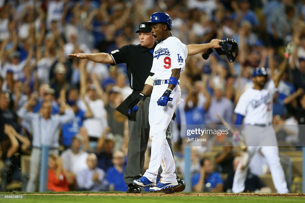 <a gi-track='captionPersonalityLinkClicked' href=/galleries/search?phrase=Dee+Gordon&family=editorial&specificpeople=7091343 ng-click='$event.stopPropagation()'>Dee Gordon</a> #9 of the Los Angeles Dodgers celebrates after being called safe at home by umpire Ted Barrett against the Washington Nationals in the fifth inning at Dodger Stadium on September 2, 2014 in Los Angeles, California.