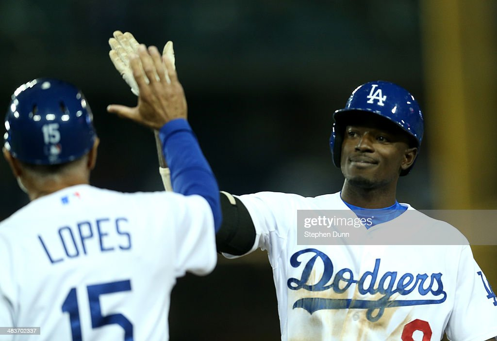 <a gi-track='captionPersonalityLinkClicked' href=/galleries/search?phrase=Dee+Gordon&family=editorial&specificpeople=7091343 ng-click='$event.stopPropagation()'>Dee Gordon</a> #9 of the Los Angeles Dodgers celebrates with first base coach <a gi-track='captionPersonalityLinkClicked' href=/galleries/search?phrase=Davey+Lopes&family=editorial&specificpeople=213048 ng-click='$event.stopPropagation()'>Davey Lopes</a> #15 after hitting an RBI single to bring in the tying run in the ninth inning against the Detroit Tigers at Dodger Stadium on April 9, 2014 in Los Angeles, California.