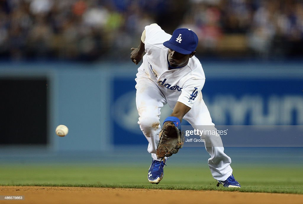<a gi-track='captionPersonalityLinkClicked' href=/galleries/search?phrase=Dee+Gordon&family=editorial&specificpeople=7091343 ng-click='$event.stopPropagation()'>Dee Gordon</a> #9 of the Los Angeles Dodgers fields a ground ball by Cody Asche of the Philadelphia Phillies in the fourth inning at Dodger Stadium on April 24, 2014 in Los Angeles, California.