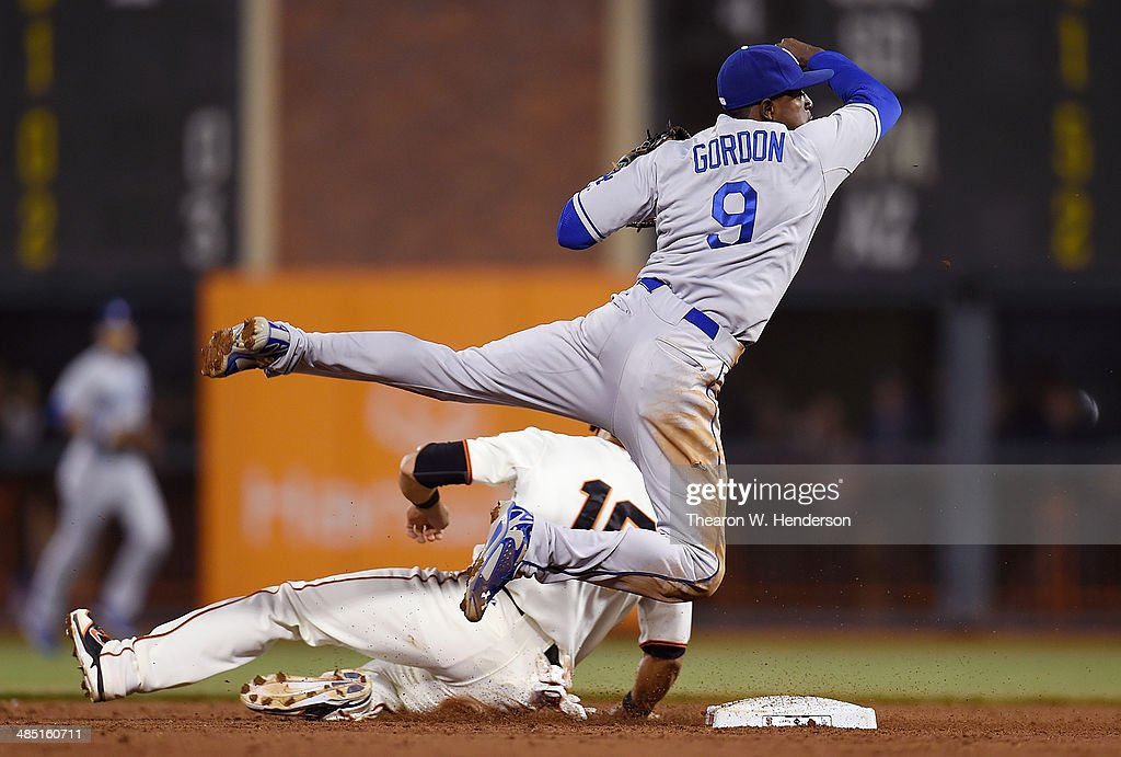 <a gi-track='captionPersonalityLinkClicked' href=/galleries/search?phrase=Dee+Gordon&family=editorial&specificpeople=7091343 ng-click='$event.stopPropagation()'>Dee Gordon</a> #9 of the Los Angeles Dodgers gets his throw off over <a gi-track='captionPersonalityLinkClicked' href=/galleries/search?phrase=Angel+Pagan&family=editorial&specificpeople=666596 ng-click='$event.stopPropagation()'>Angel Pagan</a> #16 of the San Francisco Giants but the throw was not in time to complete the double-play in the bottom of the third inning at AT&T Park on April 16, 2014 in San Francisco, California. Hunter Pence of the Giants was safe at first base.